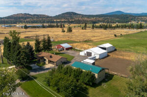 4.76 Acres of working property with Orchard, horse stables and additional living unit