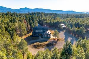 Beautiful home and outbuildings on 10 groomed acres