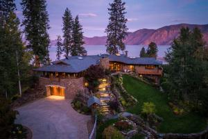 Inspirational views from every room of this 6617 SF newly constructed home on the shores of Lake Pend Oreille