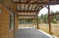 Covered entryway at rear of barn