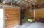 Tac room on left inside barn