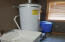 Large hot water heater & pressure tank, with washtub, in mudroom