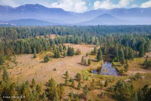 Open Pasture, Pond, Mountains