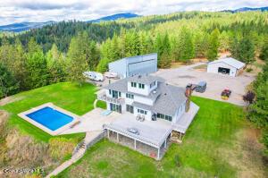 Pool, house, shop, barn on 20 acres