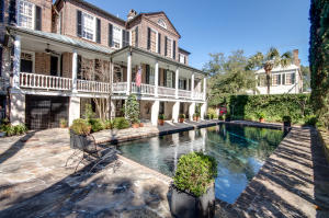 Magnificent mature gardens with privacy wall and lovely saline pool are just a few of the exterior features of this historic estate.
