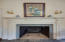 Handsome Adamesque mantel in the master bedroom frames another working fireplace.