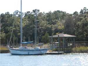 42 foot sail boat is moored at the 50ft. floater on the substantially built dock.