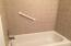 Garden tub/shower with tiled walls