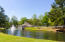 Pool and Clubhouse overlooking pond.