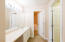 Master bathroom vanity, closet and shower room.