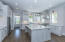 Kitchen island and hood with matching finishes