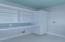 Laundry room built in closet and shelving with folding shelf. Penny tile backsplash