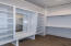 MBR Closet #1 with 3 hanging shelves with metal rods