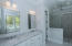Master Bath with double sink vanity, mirrors, and Carrera Marble countertops