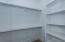 MBR Closet #2 with shelving and metal rods