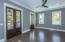 First floor Flex/den/bedroom with double doors to private front porch