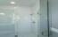 Flex room frameless shower with subway tile