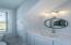 Upstairs vanity detail with custom mirror and Torquay Quartz countertop
