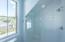 Second floor frameless shower with sloped tile ceiling