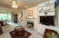Includes gas log fireplace and two built-in shelves and storage