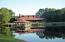 Beautiful clubhouse and lake across the street.