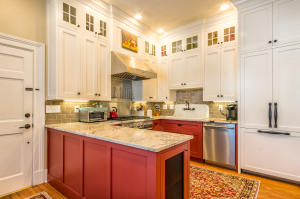 Custom cabinetry throughout the entire home and a built-in fridge