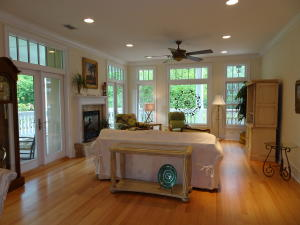 Living room is surrounded by doors leading to the wrap porch