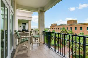 Relax on the terrace and enjoy the breeze with views of Charleston Harbor in both directions