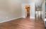 Front room leads to Kitchen, bedroom, hallway toward living room.
