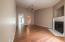 Photo taken from 3rd bedroom doorway facing living room, kitchen and hallway toward the front door.
