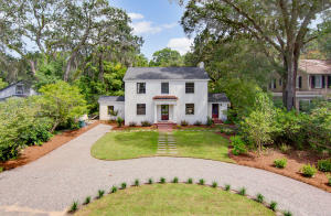 This is truly a once in a generation offering.  Classic southern charm, sophisticationYou have arrived.  Ideally Located at the end secluded end of the Avenue of Oaks you will find this well appointed4 bed 3 1/2 bath 2500 square foot brick home. To fully appreciate all of the luxury detail, you will need to tour this impeccably designed & renovated residence.   As you enter the classily designed portico with copper accents, you will realize the depth of renovation beginning with the herring bone floors & the designer lighting.  Attention to detail is evident throughout this home by viewing the brass and copper fixtures, Grohe master bath fixtures, slate floors, custom soft  close cabinets, marble counter tops, under mount lights, designer sink,  5 burner cook top, w/ pot fillerNew 200 amp service, wiring and 3 all new HVAC.  New roof, new plumbing, new exterior doors, new paint inside and out, mahogany thresholds, tankless water heater, ship lap accent wall, grand fireplace, penny round tile floors, blue stone walk ways, stone patio, crushed granite circular driveway, mature landscaping & plantings w/ lilies, Japanese maples, new sod, moss draped back yard.   Solid core interior doors, large bedrooms, Rowshambow lighting.  It is endless... 5 minutes to downtown, 10 to the beach, neighborhood boat landing, parks, community garden... Not in a flood zone.