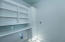 Laundry room shelves above w/d and broom closet