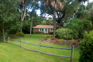 Come home to the .43 acre corner lot with mature landscaping, giant oaks and palm trees!