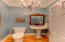 Powder room--(light fixture and mirror do not convey)