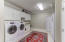 Laundry room loaded with space, storage and room for an additional fridge or freezer