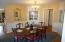Formal Dining Room - hardwood floors throughout