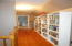 Hallway - the bookshelves can stay if the new owner wants them