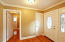 Foyer, coat closet, hall to bath and bedrooms.