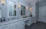 master bathroom with Carrera counter top and custom lights