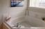 The master bath offers a soaking tub and separate standing shower.
