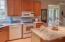 Kitchen boasts granite countertops, flush mounted sink, recessed lighting, upgraded fixtures, and pantry.