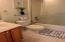 This full bath is easily accessible from the bedrooms.