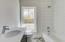 Guest bath with subway tile surround and concrete decorative tile floor