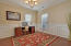 extra room downstairs for home office, formal dining, or sitting area