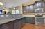 dark cabinets and granite counter tops