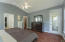 Ample master bedroom with vaulted ceilings, hardwood floors
