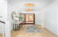 The inviting Entry Foyer with custom lighting fixtures sets the tone