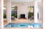 Outdoor living made easy on the ground level with two fireplaces