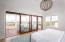 Mahogany and impact glass sliding doors in the master bedroom.