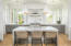 Hand selected finishes and light fixtures throughout the home complement incredible architecture by Beau Clowney